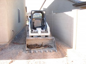 Bobcat to track out dirt